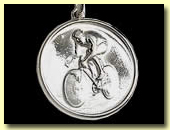 solid silver, hallmarked racing man on racing bike medallion